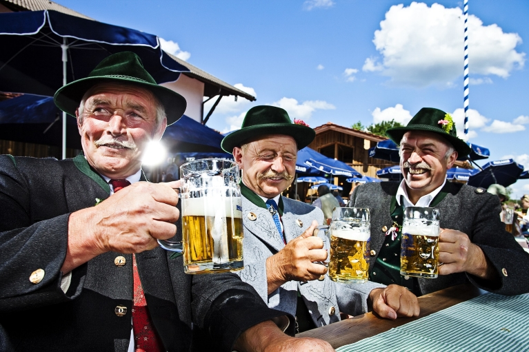 Three men in beergarden Munich