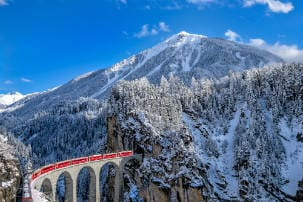 winter_travel_itinerary_-_glacier_express_running_into_the_tunnel_in_switzerland